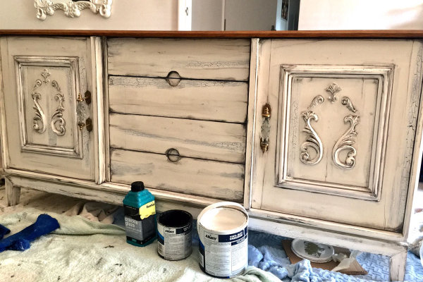 Extending to new canvases, furniture is also transformed by John's brush work