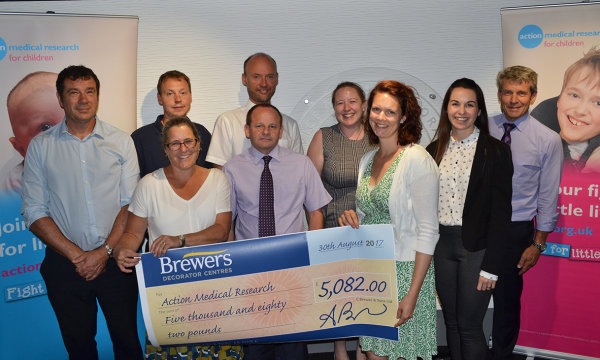 Brewers teams proudly present their fundraising efforts to Action Medical Research
