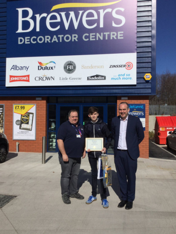 Owen Abbishaw collecting his Brewers Decorator of the Term award at Brewers Leeds