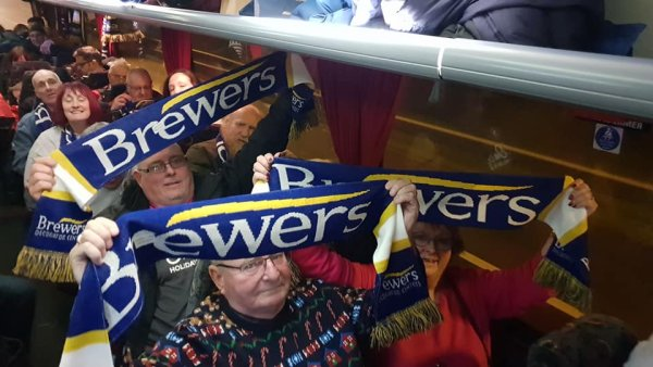 Football fans on the coach journey to watch Tranmere Rovers vs Morecambe