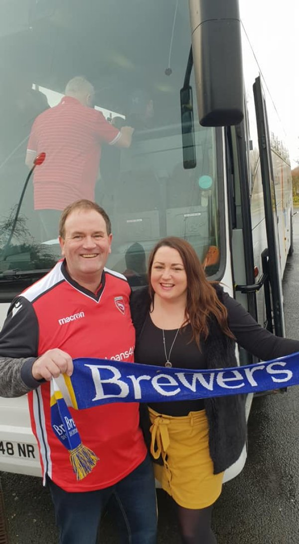 Football fans pose on the coach journey to watch Tranmere Rovers vs Morecambe